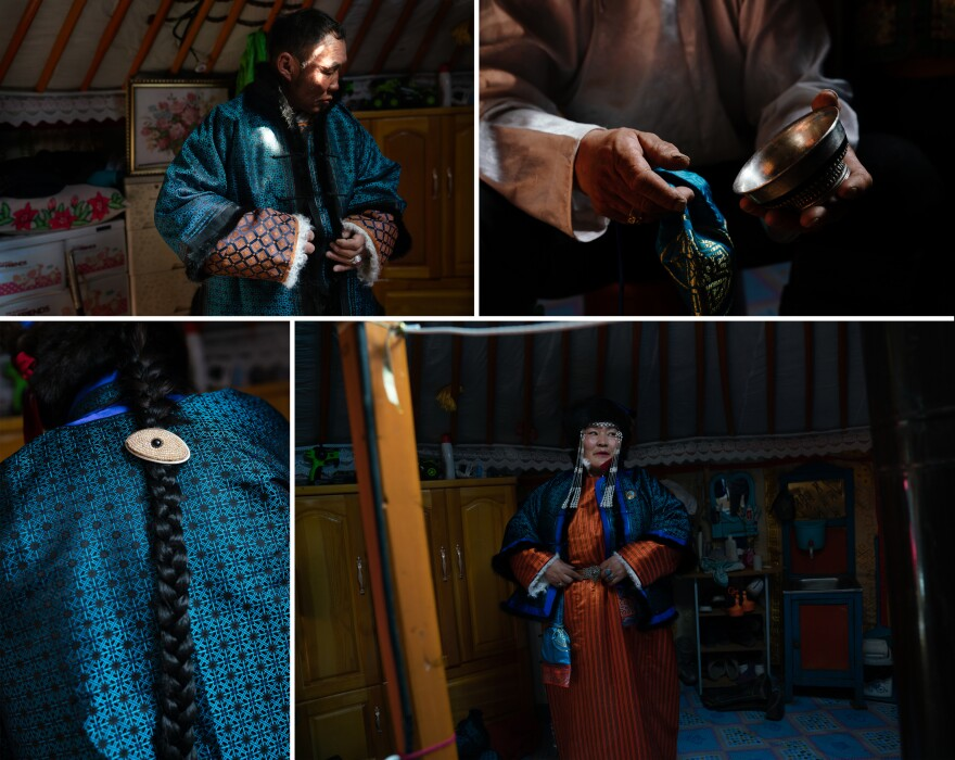 Gobi herders Enkhbaatar Dashnyam (left), 59, and Dulamsuren Yunden, 47, dress for the festival's Beautiful Couple Contest. The pair don turquoise jackets, orange deels — traditional Mongolian overcoats — and utensils and decorations passed down through the generations, including a silver bowl for drinking milk tea, and jewelry.