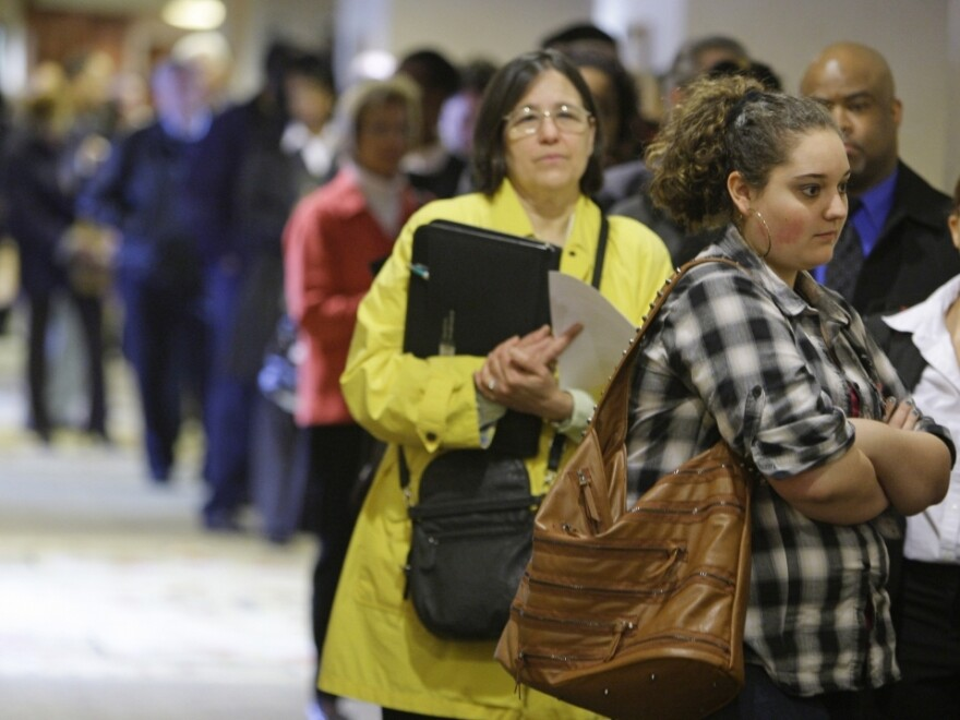 Job-seekers wait in line for a job fair to open in Independence, Ohio, last month. Employers added only 54,000 jobs in May, compared to more than 200,000 jobs a month earlier.