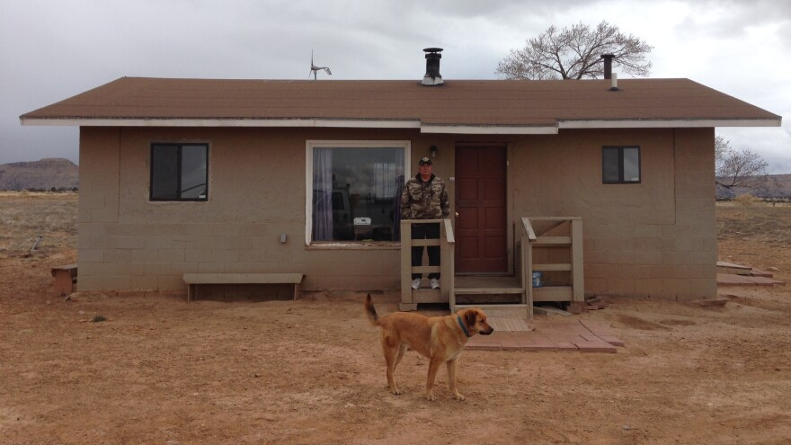Leo Thompson stands in front of his isolated home, where he has lived for 35 years, on the Navajo Nation reservation. Like an estimated 18,000 Navajos homes, his his isn't connected to the electrical grid — it's a half-mile from the nearest line — and until recently Thompson used a generator for power.
