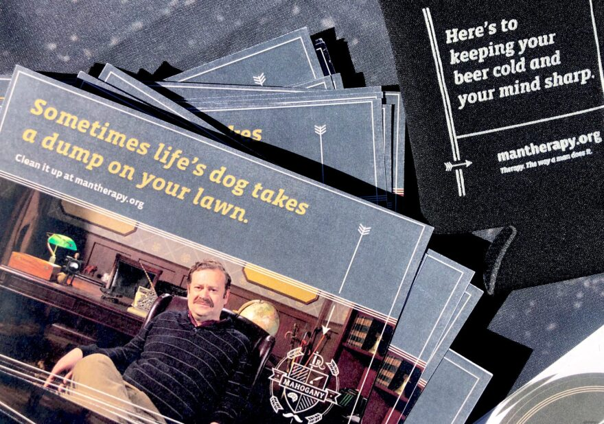 Man Therapy cards and koozies at a recent El Paso County event.