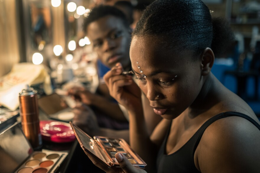 Inathi Zungula gets ready for her act backstage during a Zip Zap performance in Cape Town, South Africa. A contortionist and acrobat, she was so dedicated to making it in the circus that she made a 7-hour roundtrip commute by train to attend Zip Classes training twice a week.