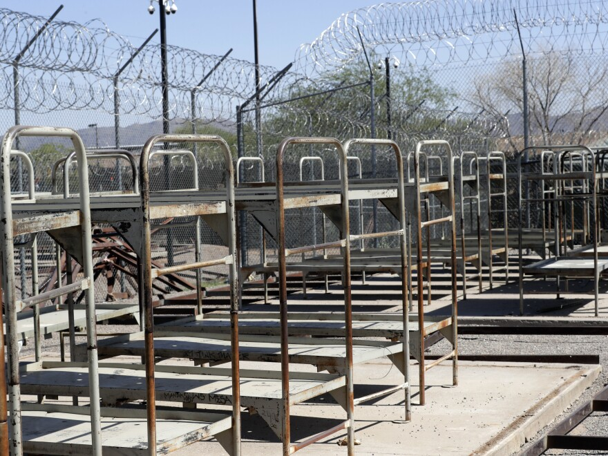 Bunk beds are exposed where tents used to shade them in the Maricopa County's Tent City Jail, in May.