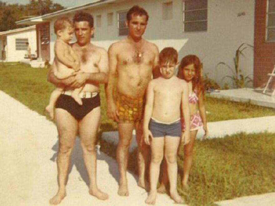 Blanco after a day at the beach, in the arms of his father, Carlos, with his Uncle Toti, brother Caco and cousin Mirita.