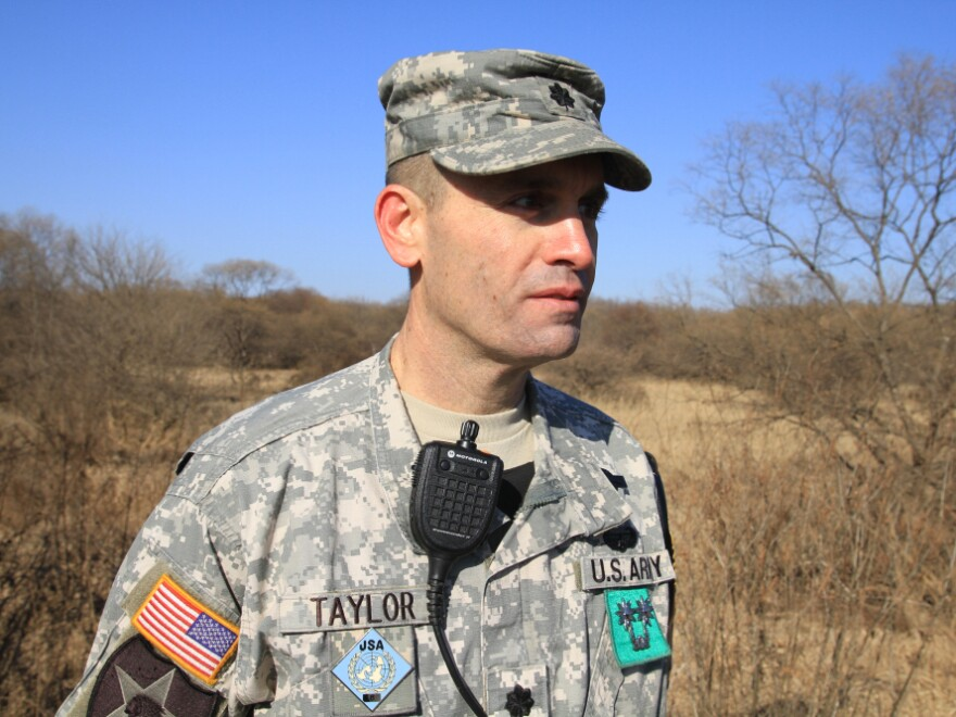 Lt. Col. Edward Taylor commands the only U.S. and South Korean battalion on the Korean Peninsula. He stands near the Korean armistice line, with North Korea behind him.
