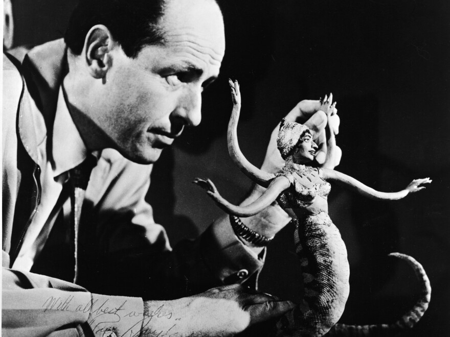 Harryhausen manipulates the figure of a serpent-like monster for a stop-motion film circa 1965.