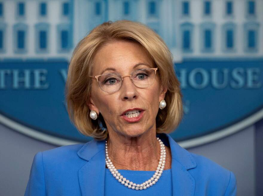 Education Secretary Betsy Devos, seen on March 27, has released new rules for sexual assault complaints on college campuses.