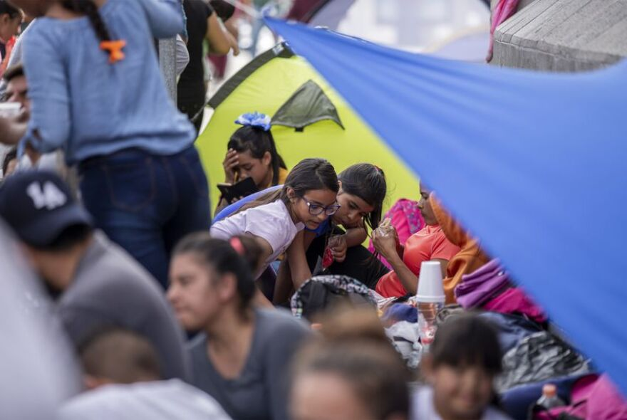 Migrants make camp at a makeshift migrant camp at the base of Paso del Norte International Bridge in Ciudad Juárez on Thursday, Oct. 3, 2019.