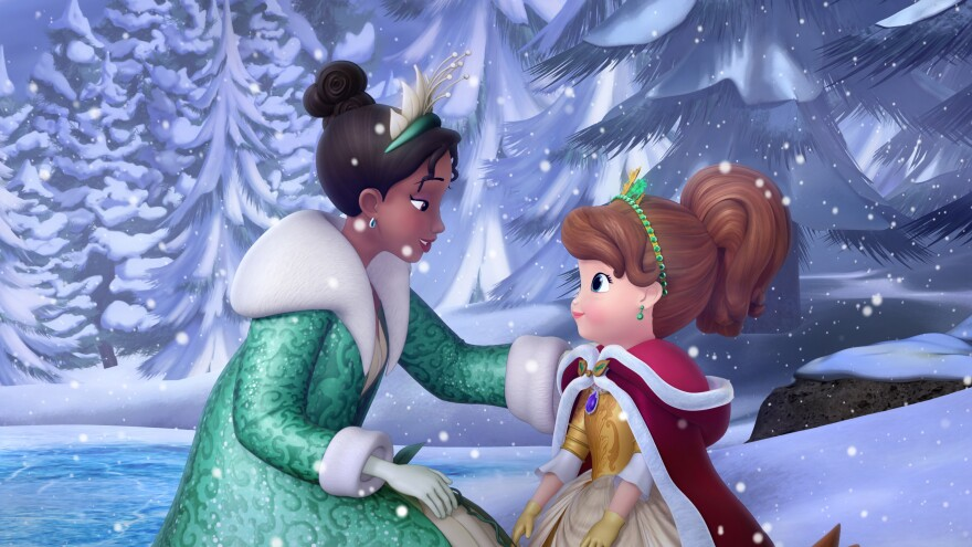 """In the """"Winter's Gift"""" episode of <em>Sofia the First,</em> Disney Princess Tiana (left) from <em>The Princess and the Frog</em> makes a special appearance to help Princess Sofia learn that a true gift comes from the heart."""