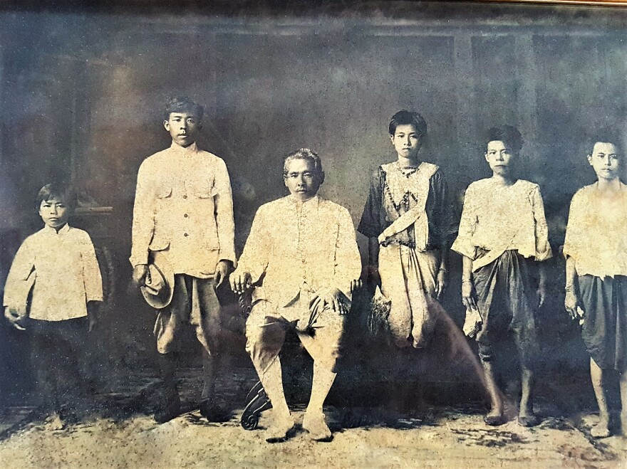 Gimsua Timkrajang, shown seated in this undated photo, was the first to make Sriracha sauce, according to his great-granddaughter. The sauce gets its name from Si Racha, the family's seaside hometown in Thailand.