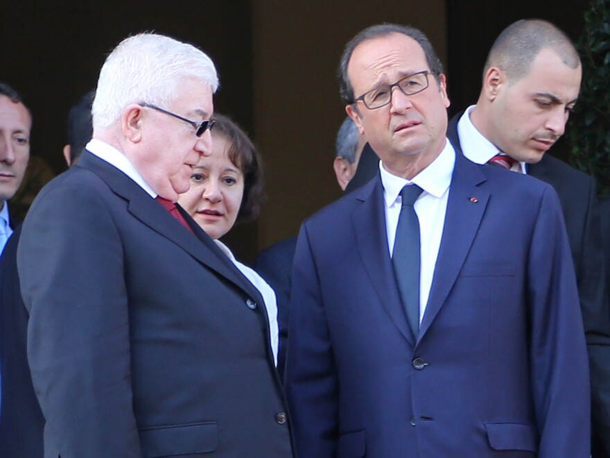 French President Francois Hollande (right) and Iraqi President Fuad Masum attend the Conference for Peace and Security in Iraq at the Ministry of Foreign Affairs in Paris on Monday. The two leaders were among those urging quick action against Islamic State militants.