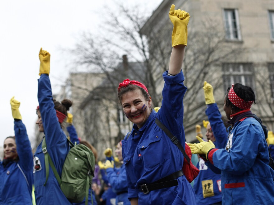 A woman laughs during a march as part of the International Women's Day in Paris Sunday.