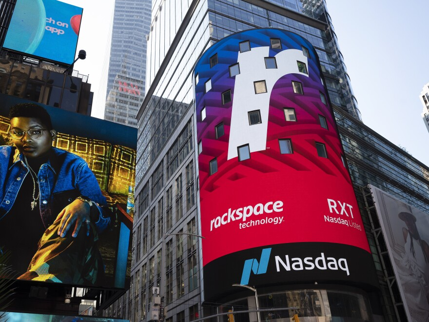 A Nasdaq sign in Times Square in New York promotes an upcoming listing on Aug. 5, 2020. Nasdaq said it will push for a rule requiring listed companies to include at least one woman and one minority or LGBTQ+ person. (AP Photo/Mark Lennihan)