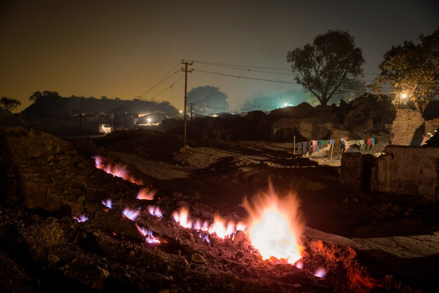 An underground fire has been burning for at least a century, according to villagers in Boka Pahari, on the outskirts of Jharia city. The fire, shown here in 2014, is some 200 yards from the village and is said to have started when abandoned coal mines were not properly closed.