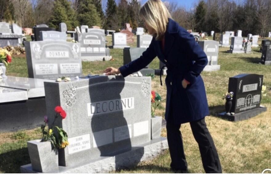 Jennifer Carrieri visits the grave of her sister, Jody LeCornu.