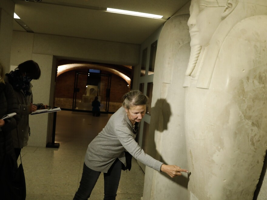 Friederike Seyfried, director of Antique Egyptian Department of the Neues Museum in Berlin, shows media a stain from liquid on the Sarcophagus of the prophet Ahmose on Wednesday.