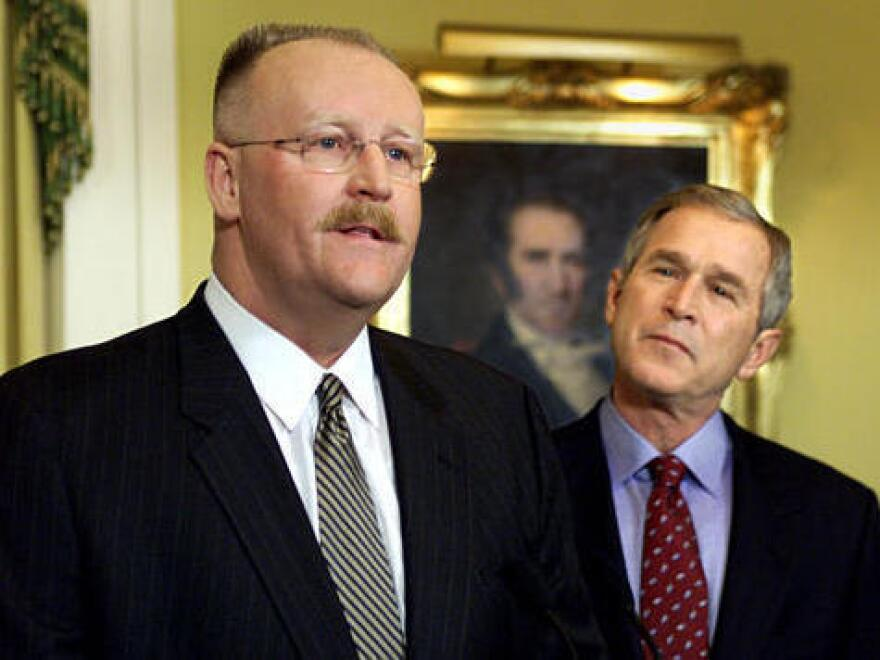 <p>Joe Allbaugh, left, speaks to the press in Austin, Texas, in this Jan. 4, 2001, photo after being named as director of the Federal Emergency Management Agency by then President-elect George W. Bush. </p>