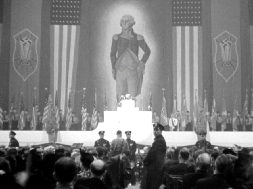 An enormous portrait of George Washington hangs alongside swastika banners and American flags at New York's Madison Square Garden in 1939 during the German American Bund's Pro American Rally.