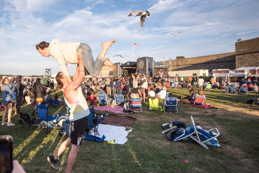 Two audience members dance during Wilco's set at the 2017 Newport Folk Festival.
