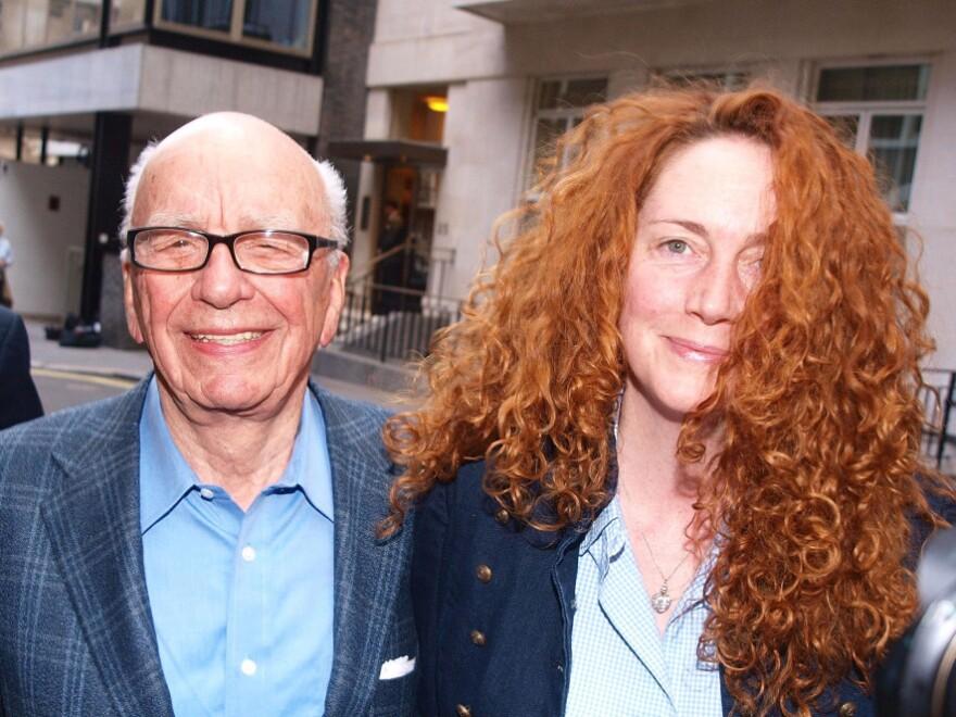 Rupert Murdoch (left) and Rebekah Brooks. Brooks resigned as head of Murdoch's News International on Friday.