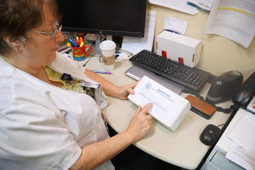 Kathy Howard, who has worked as a sexual assault nurse examiner for decades, shows an unused rape kit. Sept.  27, 2019