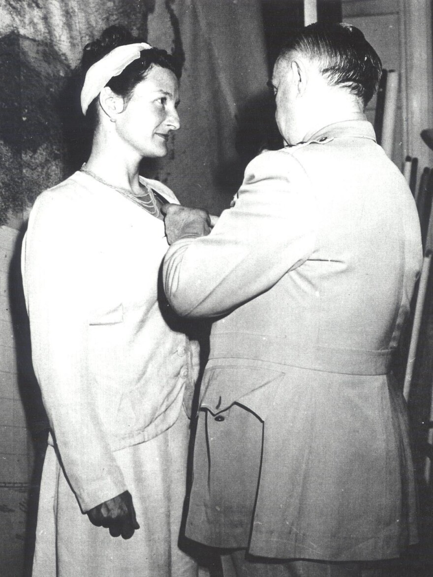 William Donovan, head of the Office of Strategic Services, presents Virginia Hall with the Distinguished Service Cross in 1945. She was the only civilian woman so honored in World War II. President Harry Truman proposed a public ceremony at the White House, but Hall declined because she wanted to stay undercover. The event with Donovan was private. The only outsider attending was Hall's mother.