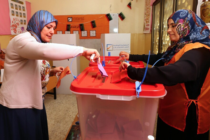 A Libyan woman cast her ballot during legislative elections Wednesday in the capital Tripoli. The voting came at a time when many Libyans were fed up with the chaos and unrest in the country.
