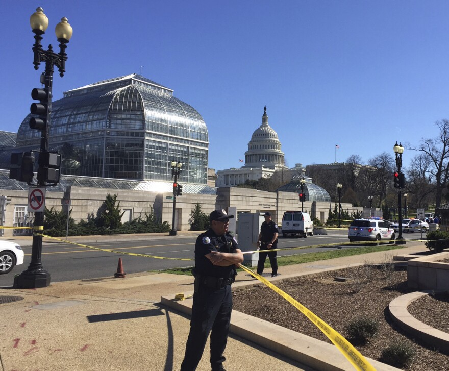 Police stand guard at the Botanic Garden after the incident near the U.S. Capitol on Wednesday.