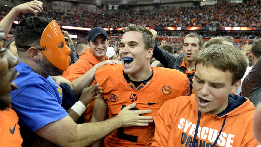 Syracuse quarterback Eric Dungey celebrates with fans after his win over Clemson Friday night in Syracuse, N.Y. The Orange upset the Tigers 27-24.