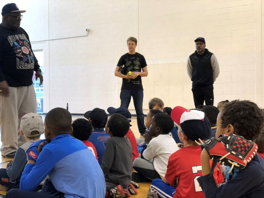 Andre Lee, president of Senators Satchel Paige Little League, talks to the kids after the baseball clinic.