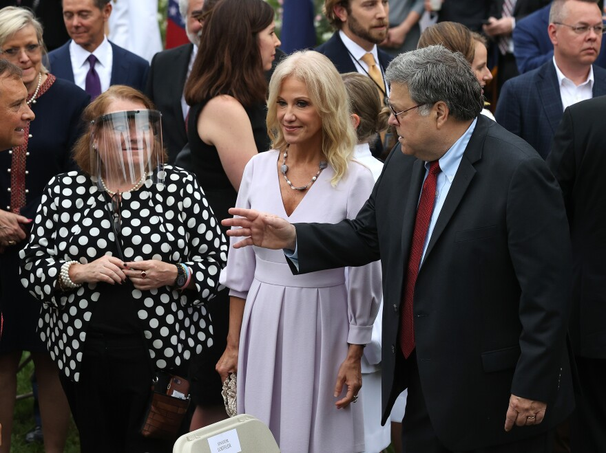 Kellyanne Conway and Attorney General William Barr talk with guests in the Rose Garden.