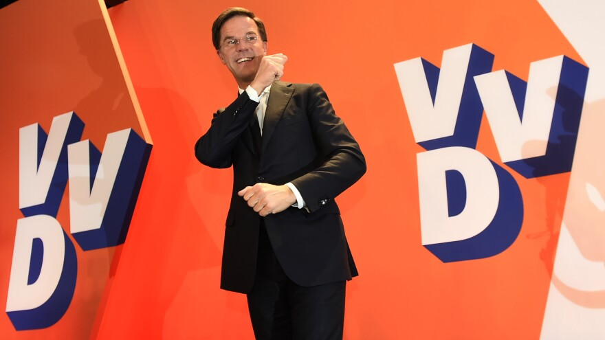 The Netherlands' Prime Minister Mark Rutte celebrates a big win by his VVD party in The Hague. Wednesday's vote will force far-right politician Geert Wilders into second place along with two other parties, the Christian Democratic Appeal and the Democracy party D66, exit polls predict.