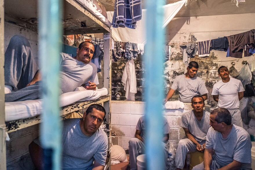 Sergio Gonzalez (top bunk, left) lies on his bunk in Tijuana's La Mesa prison, where he was jailed the previous February for holding more crystal meth than legally allowed. He is HIV positive as is his young son, Eduardo, who now lives in an orphanage.
