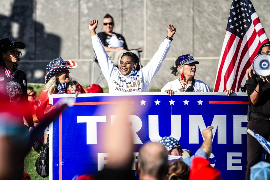 A marcher shows her support for President Trump.
