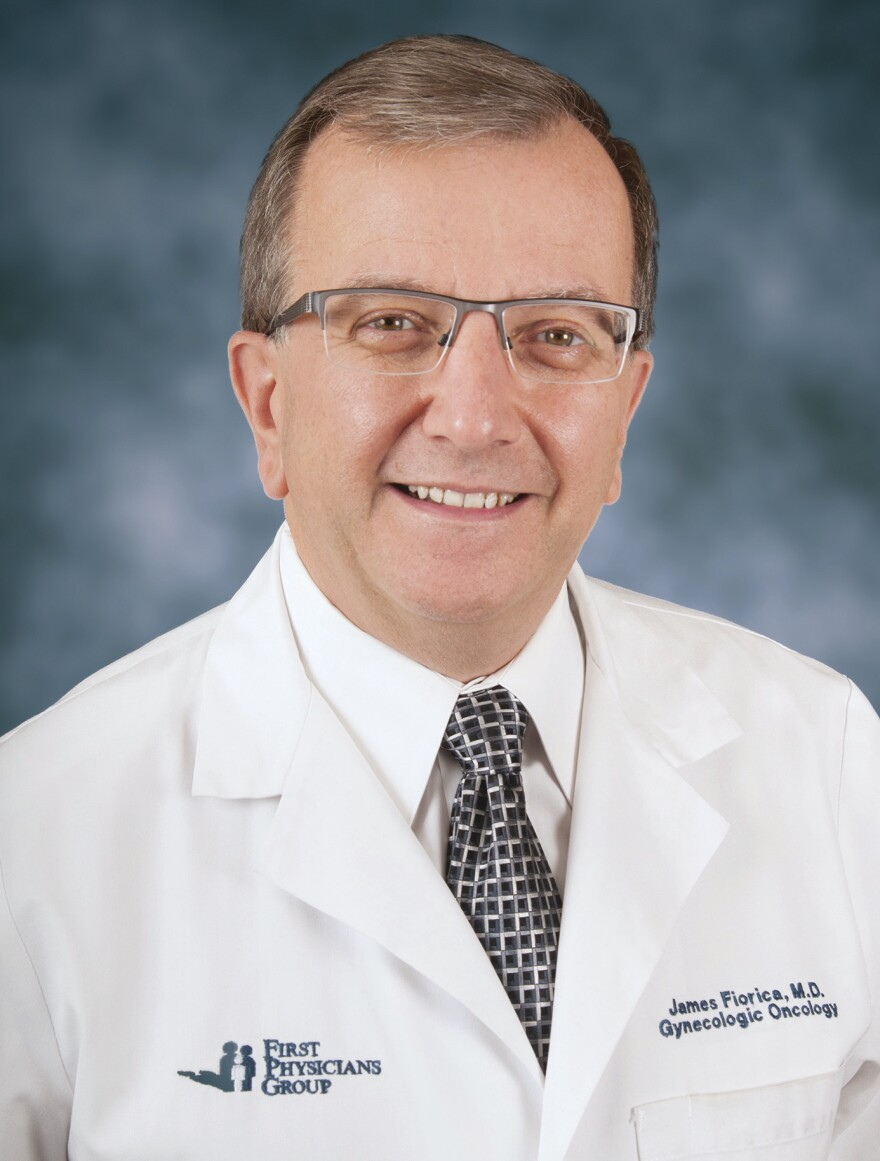 Headshot photo of a white, male doctor in a labcoat.