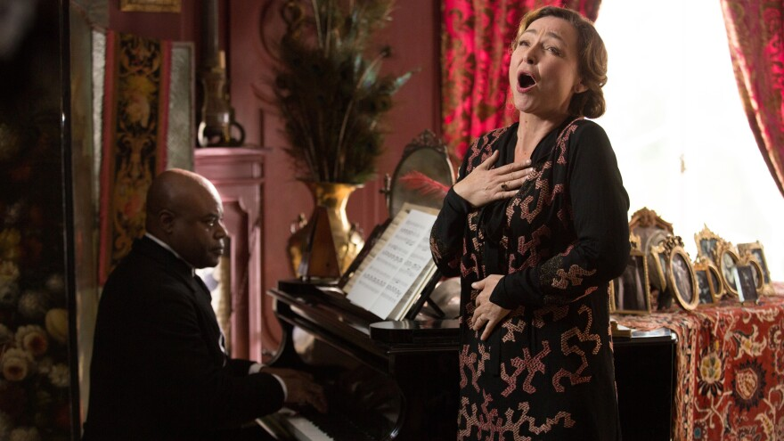 Catherine Frot plays an opera-loving socialite in <em>Marguerite</em>. (Also pictured: Denis Mpunga)