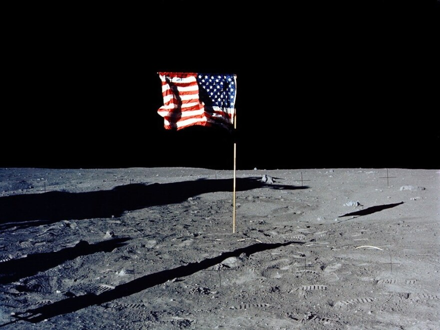 The U.S. flag stands alone on the surface of the moon.