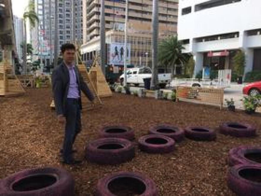 Ken Russell, Miami's District 2 commissioner, shows off tires repurposed for a children's playspace in the pop-up park along Biscayne Boulevard.
