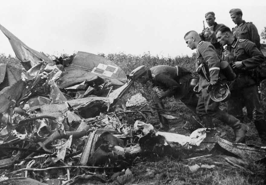 German soldiers inspect the wreckage of a Polish army plane shot down by a German pilot during an air raid, Sept. 8, 1939. (AP file photo)