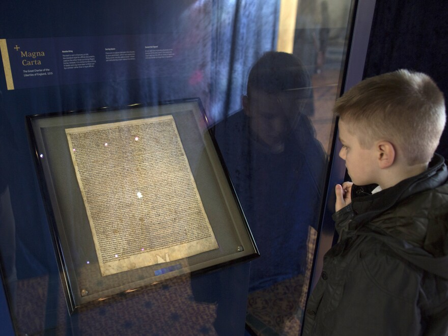 British police say a man tried to steal the Salisbury Cathedral's Magna Carta, one of four original documents that have survived. Here, a schoolboy looks at the Magna Carta in the cathedral's Chapter House.