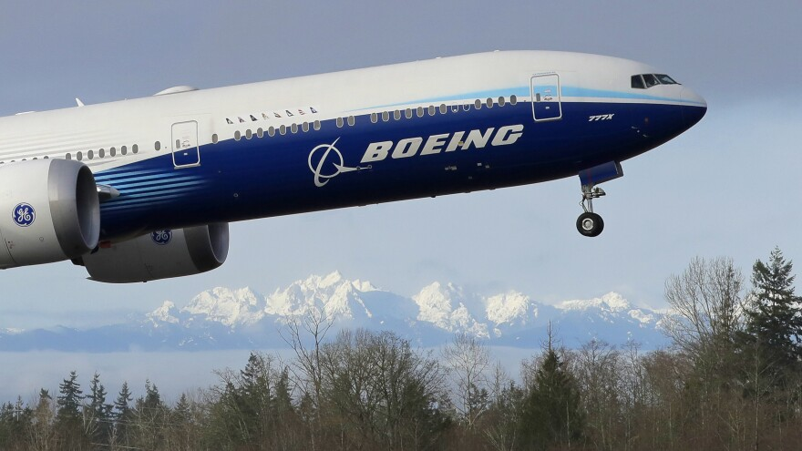 Boeing is reporting a loss of $8.4 billion in the fourth quarter on weaker demand for planes during the pandemic.