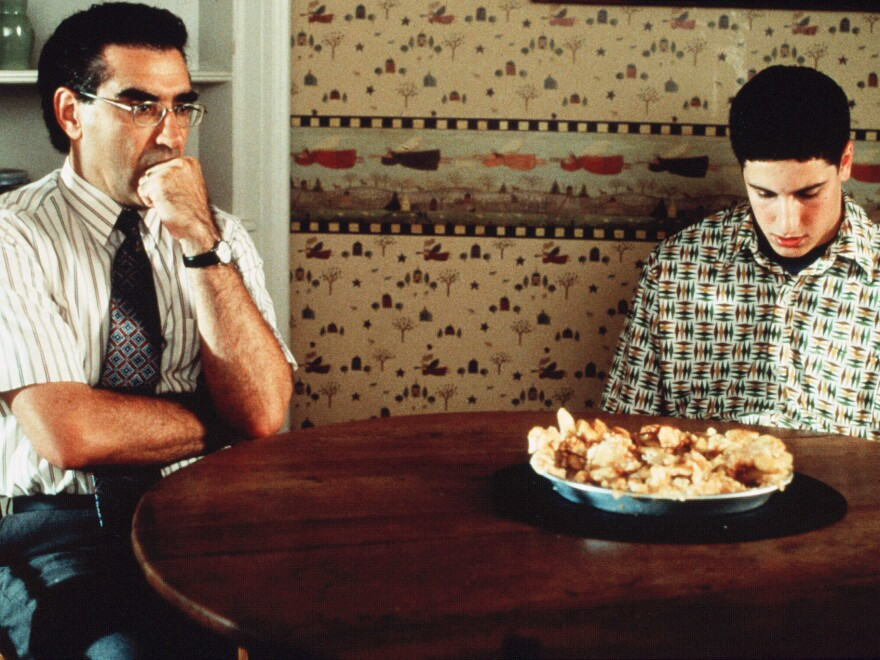 Eugene Levy with Jason Biggs and the now-infamous defaced pie in one of his most popular recurring roles as Jim's dad in <em>American</em> <em>Pie</em>.<em></em>