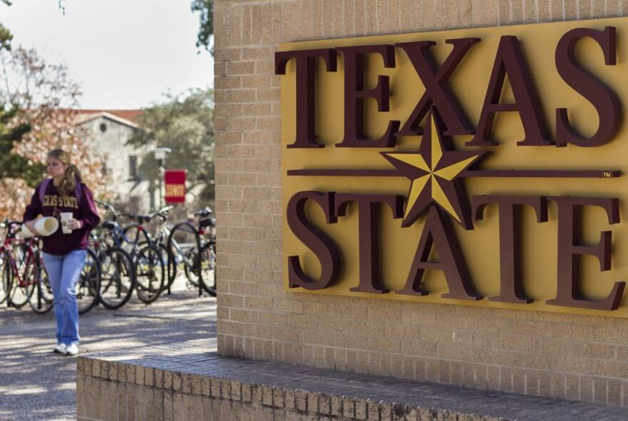 """Students walk through """"The Quad"""" at Texas State University."""