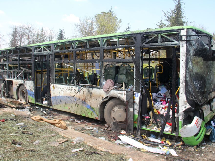 A picture taken April 16 shows the damage a day after a suicide car bombing attack in Rashidin, west of Aleppo, targeted buses carrying Syrians evacuated from Fuaa and Kafraya, two besieged Shiite villages.