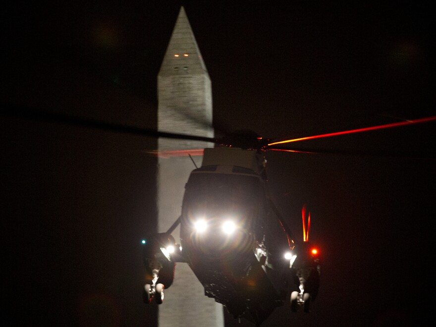 The Marine One helicopter carrying President Obama returns to the White House on Friday after Obama spent the day campaigning in Ohio. Both the president and Mitt Romney were to be on the road all weekend, campaigning in a handful of swing states.