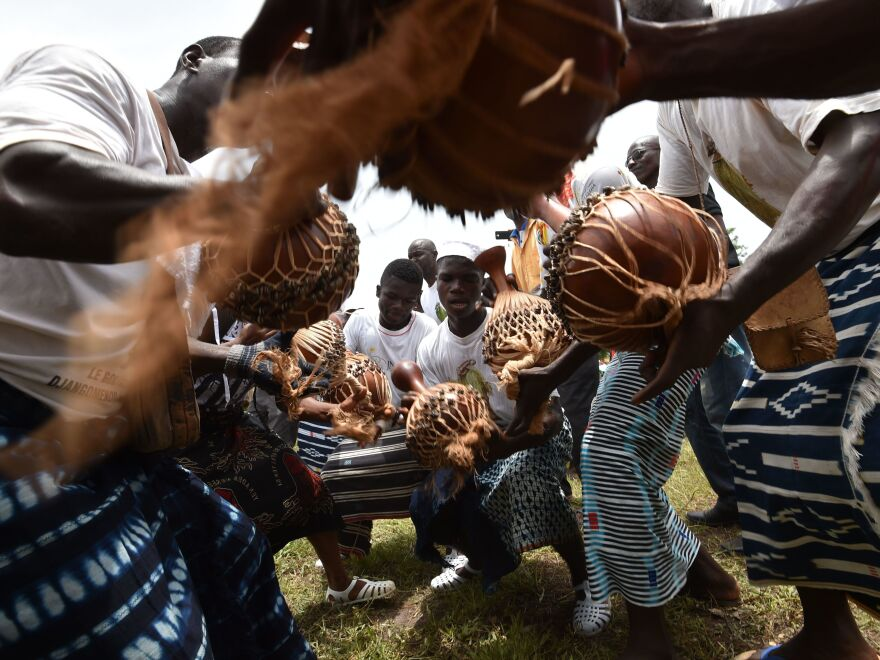 "Goly dancers from the Baoule community, one of the Ivory Coast's largest groups, perform in a youth residence in Assounvoue village during ""Paquinou."" It is an Easter celebration with reconciliation, food, music and dance."