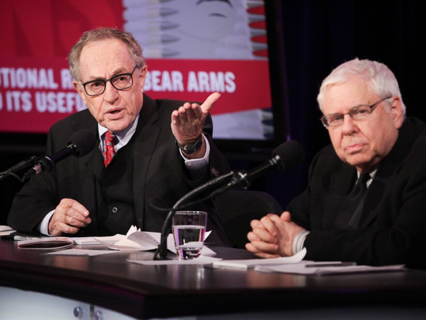 """Alan Dershowitz and Sanford Levinson argue in favor of the motion """"The Constitutional Right To Bear Arms Has Outlived Its Usefulness"""" in an Intelligence Squared U.S. debate on Nov. 14."""