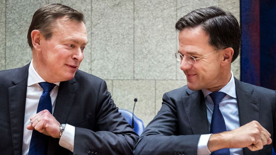 The elbow bump has replaced the handshake in many situations, including this greeting between Dutch Prime Minister Mark Rutte (right) and Dutch Minister for Medical Care Bruno Bruins in The Hague, Netherlands, on Tuesday.