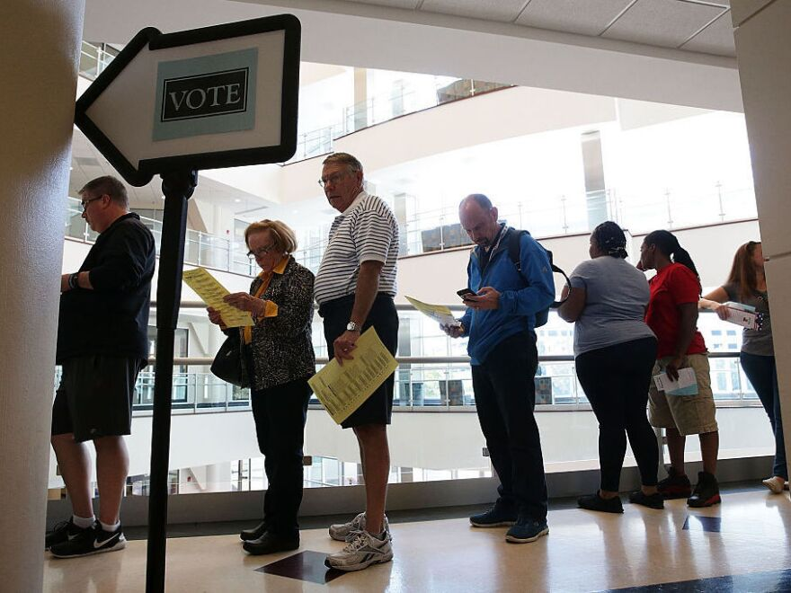 Voters in Winston-Salem, N.C., wait in line to cast their ballots during early voting for the 2016 general election.