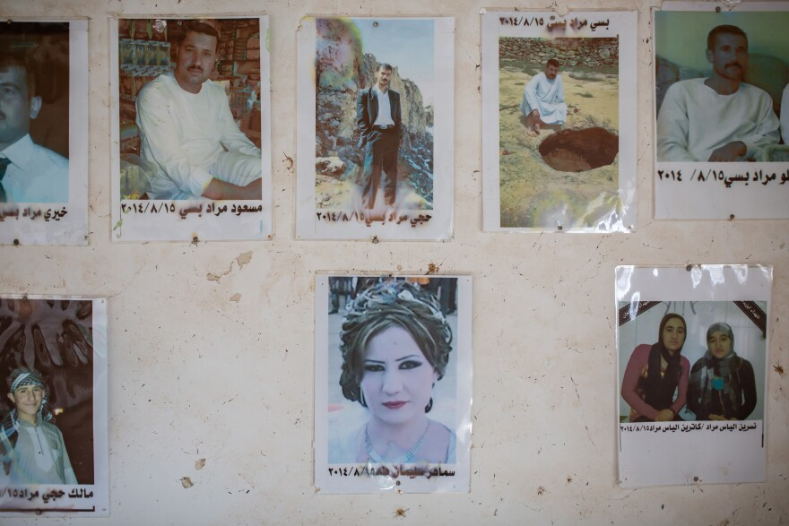 Photos of family members killed by ISIS hang on the wall in the Murad family home in Kocho, northern Iraq.