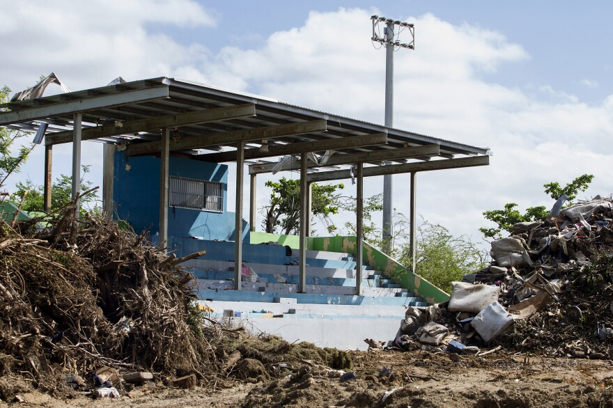 A soccer field in Toa Baja, Puerto Rico, has become an improvised dump site because the main municipal landfill is so busy.